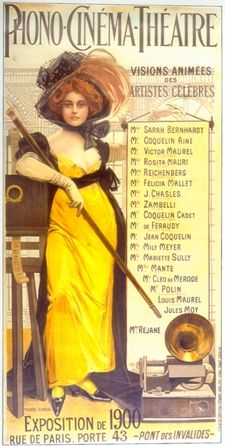 """Illustration of a red-haired woman wearing a large hat, an ankle-length yellow dress, and high heels. She is holding a long baton or swagger stick and leaning against a film projector. A gramophone sits at her feet. The top of the illustration reads """"Phono-Cinéma-Théâtre"""". Text to the left of the woman reads """"Visions Animées des Artistes Celèbres"""", followed by a list of performers."""