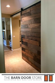 "Our clients in Waddell, AZ rang in the New Year with a brand new #custombarndoor.  Horizontal mixed plank Black Hardware 4"" classic wheels Fife Handle Barn Door Location: Closing up hallway from great room **Get your custom barn door ordered today!*   #BarnDoors #BathroomDoors #BedroomDoors #CustomBarnDoors #CustomDoors #Doors #HomeDecor #BedroomDecor"