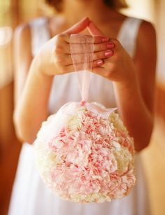 The flowers girls will carry pomander balls of pale pink hydrangeas and spray roses hanging from black ribbon.