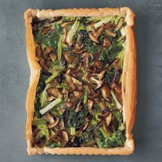 Vibrant spinach leaves intermingle with roasted mushrooms in a light-as-air (and easy-to-assemble) phyllo shell. The custardlike filling comes together quickly in a blender.