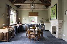 From the black sink unit with its ornate mouldings to the oak and beech butcher's block, this bold, overstated kitchen really is top of the class in every respect.