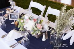 White linens, navy table runners, white garden chairs, succulent centerpieces, pink white green navy blue, mercury glass. Planning a Michigan Wedding with Pearls Events