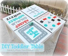 DIY Toddler Game Table using a cheap Ikea end table and vinyl... many possibilities for adapting this.