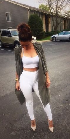 Cute green cardigan contrast with all white outfit