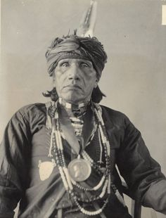 Portrait of Emi-dughra, known as John Ford.  Part of Siouan (Sioux) and Iowa Tribes.  1901.