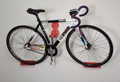 The Dan pedal hook is a horizontal bike storage system. It& easy to use and offers the display look of shelves and brackets at a lower cost. Bike wall mount for all bikes. Bike Storage Systems, Bicycle Storage, Bicycle Rack, Bicycle Wheel, Bike Hooks, Bike Hanger, Garage Velo, Bike Wall Mount, Folding Mountain Bike