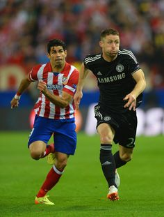 Diego Costa competes with Gary Cahill during the UEFA Champions League semi final first leg match between Club Atlético de Madrid and Chelsea at Estadio Vicente Calderón on April 22, 2014 in Madrid, Spain.
