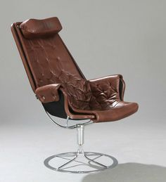 """Bruno Mathsson: """"Jetson"""". Armchair with chromed steel frame and brown leather."""