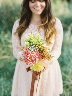 peach bridesmaid dress and wildflower bridesmaid bouquet. We love!