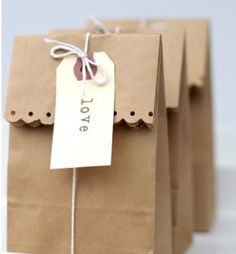 Brown paper bag with scalloped edges; hole punch to decorate. Twine and tag.