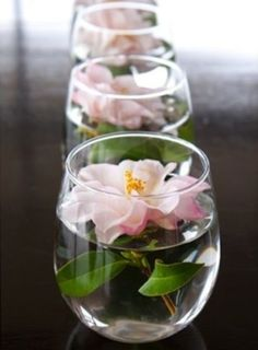 For the center pieces - floating white daisy in food colored water with two or three plastic champagne glasses upside down and tea lights wrapped in matching color washi tape on top