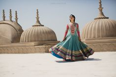 J Dhillon Photography Stunning bridal outfit mutlicoloured - can't believe this is a real bride! her wedding photo shoot is like something out of a movie.