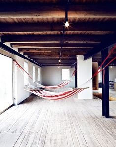 10 Relaxation-Inducing Indoor Hammocks. Love the placement of this hammock but not necessarily the design of the fabric.
