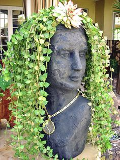 """Gorgeous Female Head Planter This handmade terracotta blend planter, has an aged finish and will develop a weathered appearance if left outdoors. It will lend a classic sophistication to any garden. The head measures 8"""" X 8"""" X 17"""" tall and the shipping weight is approximately 25lbs. Avoid freezing temperatures. Take them inside for winter. $108.00  Includes Shipping/Handling"""
