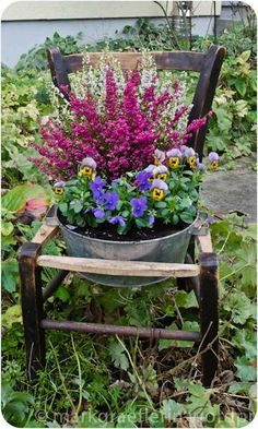 Galvanized tub flower pot in old chair - beautiful repurposing for the garden...to go with our troughs outside the shop? @Melissa Squires Squires Squires Squires Squires Kiefer