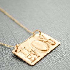 Nothing says I Love You like a gold colored Bronze necklace that says I love you.      By Chocolate and Steel
