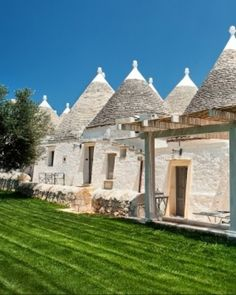 Masseria Fumarola is made up of iconic cone-shaped trulli buildings, typical of the region.