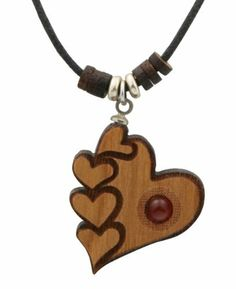 Laser Cut Cherry Wood Hearts Pendant Necklace with Carnelian Cultural Elements. $12.00. Made in the USA. Cord adjustable from 15-30 inches. Made of cherry, Laser cut details. Carnelian embellishments. Pendant measures 1 x 0.8 inches