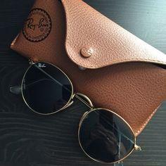 RayBans round metal glasses- gold frame and black lenses or the dark green lense!