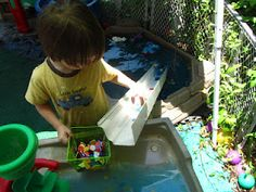 outdoor water play with a marble chute
