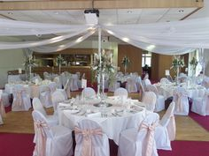Chair covers with blush taffeta sash & diamante buckle. Candelabras with floral dressing Event Venues, Wedding Venues, Wedding Reception, White Chair Covers, When We Get Married, Ashley Furniture Chairs, Wedding Linens, Flower Arrangements, Wedding Flowers