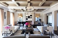 3. Work in pairs. Create a sense of symmetry by doubling up on pieces for a visually balanced look. The generous proportions of both Kourtney and Khloé's family rooms allowed Bullard to incorporate matching pairs of lighting, seating, and casegoods.