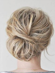 The Messy Bun Hairstyle for Mid-length Blond Straight Hair (but it would work for curly, too, right?)