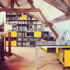 A farmhouse style private residence (France). An expansive office-library, where…