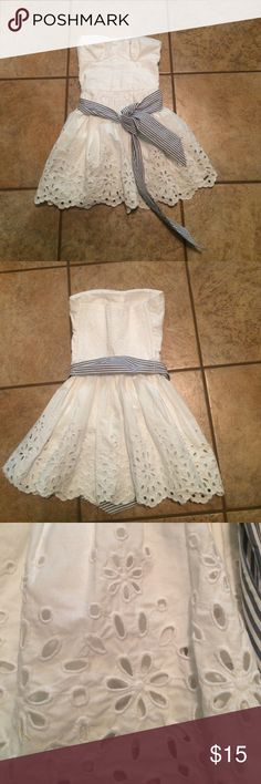Hollister summer dress This dress is great to kick off the summer it has flowers along the bottom and along the top. It does run short but is great for family pictures at the beach. It was only worn one time. Hollister Dresses Strapless