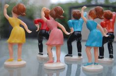 vintage birthday cake toppers, looks like they have their shaking a bootie. lol