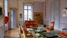 One of the sitting rooms is fit for the lord and lady of the manor as the couple give it their own unique touch