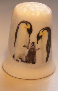 Penguin with young porcelain thimble These are for sale by https://www.speelgoedenverzamelshop.nl/vingerhoedjes/dieren/pinguin_bedrukt_op_een_porselein_vingerhoedje_(hmpin18).html