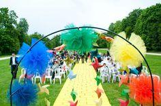 rainbow wedding aisle runner | rainbow poof altar with oragami over a yellow brick road aisle runner ...
