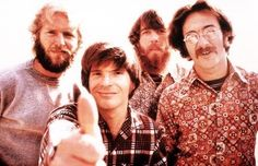John Fogerty gives the thumbs up with Creedence Clearwater Revival