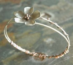 Sweet Magnolia Sterling Silver and Copper Bangle http://media-cdn.pinterest.com/upload/252201647852599438_Q0MAj6cf_b.jpgby sophiapip, $65.00