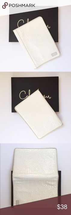 """Cole Haan Tablet Case Cole Haan Tablet Case...alligator embossed patent leather in winter white...suede interior...card pocket..elastic tabs hold your notebook or tablet in place...original box included...pre-loved but has been professionally cleaned. Size 7.5"""" x 10.5"""". Retail $158 Cole Haan Accessories Tablet Cases"""
