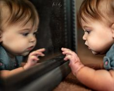 Reflections are hours of entertainment for a baby.