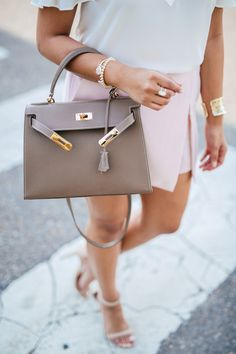haute off the rack, blush skort, lace-up cold shoulder cami, white blouse, nude ankle strap heels, eva handbag, teddy blake handbag, women's handbag, kendra scott jewlery, women's fashion, rayban round sunglasses, express, spring outfit, spring style, summer outfit