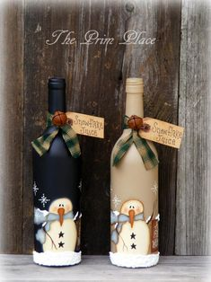 This Primitive Snowman Wine Bottle ~ Snowman Decor ~ Christmas Decor ~ Winter Decor ~ Snowmen ~ Christmas Gift ~ Painted Wine Bottle is just one of the custom, handmade pieces you'll find in our ornaments & accents shops.These mauve container designs Liquor Bottle Crafts, Recycled Wine Bottles, Wine Bottle Art, Painted Wine Bottles, Lighted Wine Bottles, Diy Bottle, Beer Bottle, Decorated Bottles, Bottle Labels
