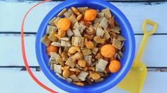 Throwing a beach-themed bash? This ocean-inspired snack mix is a cinch to make and equally easy to eat. - Beach Ball - Ideas of Beach Ball Chex Mix, Chex Party Mix, Dog Food Recipes, Snack Recipes, Cooking Recipes, Kid Recipes, Recipies, Dessert Recipes, Beach Ball Party