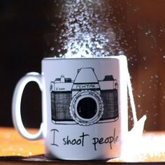 This I Shoot People Novelty Mug is an otherwise ordinary white ceramic coffee mug from Twisted Envy.