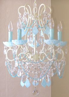 The 5 Light Beaded Chandelier with Milky Opal Aqua Blue Crystal combines timeless design with modern color. This chandelier is painted ivory then adorned with gorgeous Milky Opal Aqua Blue French pendants and matching fancy cut bobeches 5 Light Chandelier, Beaded Chandelier, Crystal Chandeliers, Painted Chandelier, Chandelier Makeover, Vintage Chandelier, Cinderella Bedroom, Lustre Vintage, Frozen Room