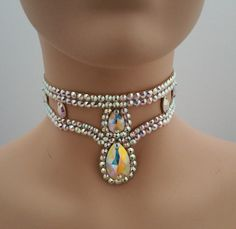 This Pear drop choker was created with Crystallized™ Swarovski Elements Aurora Borealis clear crystals. The choker attaches in the back with velcro. This unique design will work with most dress neckli