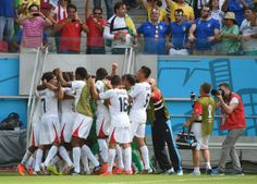 Costa Rica Edges Italy 1-0 To Clinch A Spot In World Cup Round Of 16 Costa Rica's players celebrate after their team scored against Italy during a Group D football match between Italy and Costa Rica at the Pernambuco Arena in Recife during the 2014 FIFA World Cup on June 20, 2014.
