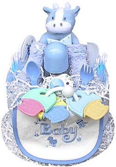 This colorful and fun boy-themed Diaper Cake is sure to charm the lucky gift recipient! Present one as a baby shower gift, or use it as a creative shower centerpiece. Every item in the Diaper Cake is