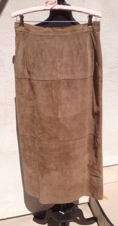 A personal favorite from my Etsy shop https://www.etsy.com/listing/185471246/vintage-1980-brown-suede-skirt-classic