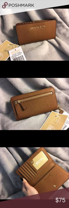 Micheal Kor Jet Set Tech Wristlets New. With tag. Not fit iPhone + or any bigger phone. Michael Kors Bags Clutches & Wristlets