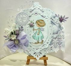 How pretty by DT Julie, Marianne products used: Stamp DDS3309 Dies: LR0240 Petras Large Ovals, LR0281 Petras Corners Roses: Lavender mix RB2216