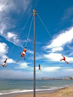 ... and twisting through the sky 13 times, Voladores are one of the many entertaining shows that can be seen along the beach in Puerto Vallarta, Mexico.