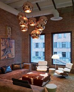 Sensational Living Room Interior In Stylish Elegant With Iconic Eames Chair Furniture Exposed Brick Wall And Chrome Chandeliers | http://emfurn.com/products/eames-lounge-chair #eames lounge chair,  eames lounge design